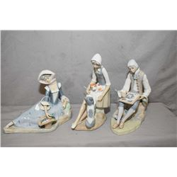 Three Spanish made Casade pottery figurines including recline girl with flower basket, girl with two