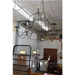 Selection of wrought iron including chandeliers, wall sconce and a candleholder in a hanging globe