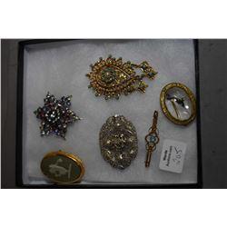 Six vintage brooches including Jasperware by Wedgwood, rhinestone , reverse painted glass pheasant b