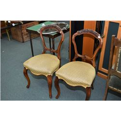 Two matching antique mahogany side chairs with upholstered seats