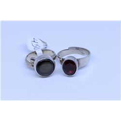 Two sterling silver rings including bezel set oval garnet gemstone ring and a bezel set star sapphir