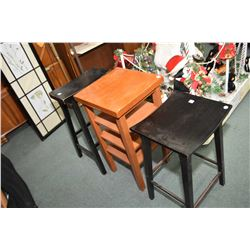 Two semi contemporary stools with simulated ebonized finish and a four tier mission style stand
