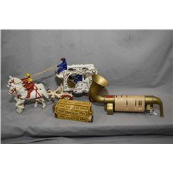 Cast Overland Circus horse drawn calliope toy and a Q. R. S. Playasax musical mouth organ with four