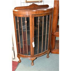 English mahogany curved curio cabinet with two glass shelves and carved ball and claw feet