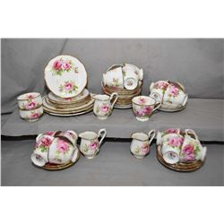 Large selection of Royal Albert American Beauty china including 23 saucers, 17 tea cups, three cream