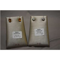 Two pairs of ladies 14kt yellow gold earrings including oval citrines gemstone and faux diamond soli