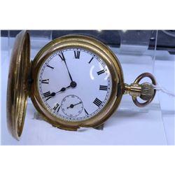 """English """"16"""" size half hunter pocket watch, 15 jewel, dates to 1900, with split nickel plate stem wi"""