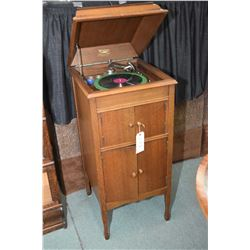 Oak cased Melotone 78rpm gramophone with record storage plus a selection 33 and 78 rpm records, work