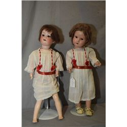 """Two antique dolls including 18"""" Armand Marseille 390 doll with bisque head, sleep eyes on compositio"""