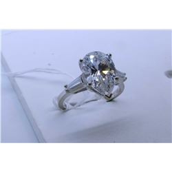 Ladies 14kt white gold ring set with pear shape cubics with baguette accents