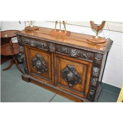 Antique European oak cabinet with multiple carved faces, grape, leaf and crest designs with beautifu
