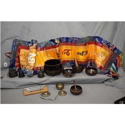 Selection of Tibetan musical singing bowls with striker, a small chime etc plus an embroidered wall