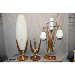 Three mid century lamps including a pair of teak table lamps, one sans shade and a walnut three glob