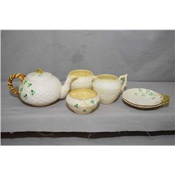 Selection of green mark Belleek including tea pot, open cream and two sugar bowls plus two handled s