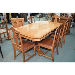 Refractory style oak dining table with jack knife leaf, plus six chairs including one carver