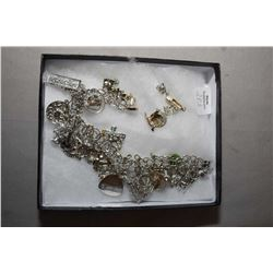Sterling silver charm bracelet and filled with silver charms and a selection of loose silver charms