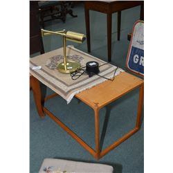 Brass desk lamp, small throw rug and a teak coffee table