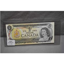 Ten non-circulated 1973 Canadian one dollar bills with sequential serial numbers