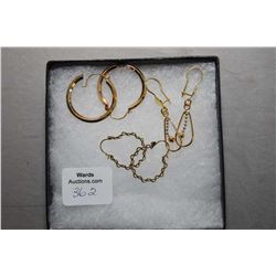 Three pairs of gold earrings including 18kt yellow and white gold dangling earrings, 10kt hoops and