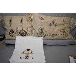 Pair of arts and crafts embroidered crewel work cushions with tassels and a crewel work table runner