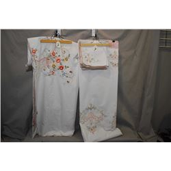 """Two tablecloths including pierced and embroidered cloth with 10 napkins, 68"""" X 100"""" and a 80"""" X 64"""""""