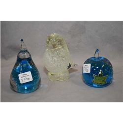 Three vintage Alta glass paperweights including apple, pear and a bird, all with original labels