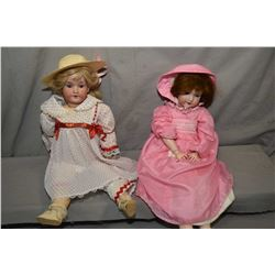 """Two antique bisque head dolls on composition bodies including Armand Marseille 390 3 1/2, 22"""" in hei"""