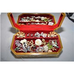 Jewellery case filled with vintage costume brooches, silver locket, rings etc.