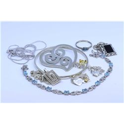 Two trays of sterling silver jewellery including necklaces and pendants, earrings, heart shaped broo