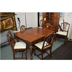 Antique dining room suite with dining table with jackknife leaf, six chairs including one carver and
