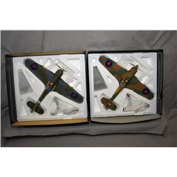 "Two Corgi 1:32 scale die cast planes including ""Hawker Hurricane"" and a ""Hawker Sea Hurricane"", both"