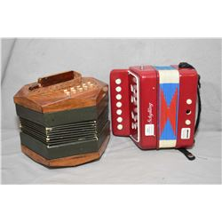 Schylling mini accordion and a vintage wooden squeeze box