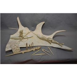 Selection of hand carved collectibles including antler diorama with spear hunter and narwhals, an el