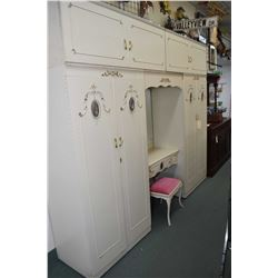 Painted French style fitted wardrobe unit including double wardrobes, top storage surrounding a mirr