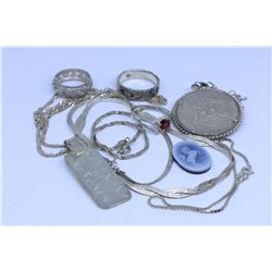 Two trays of sterling silver jewellery including 1964 American silver half dollar in pendant holder