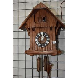 German made triple train cuckoo clock plus a selection of small wooden decorative figures, possibly