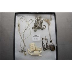Selection of vintage jewellery including Elephant ivory brooch, sterling locket and chain, marcasite