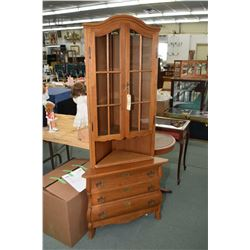 Oak corner cabinet with three drawer base and two door glazed display upper
