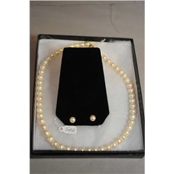 "Strand of 16"" genuine pearls with a 14kt gold clasp and a pair of pearl stud earrings with 10kt gold"