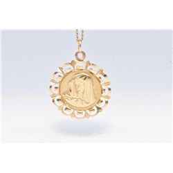 "Ladies 10kt yellow gold Madonna motif pendant and a 10kt yellow gold 20"" neck chain"