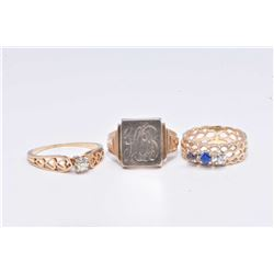 Three ladies gold rings including 14kt yellow gold and solitaire diamond ring, 14kt white and yellow