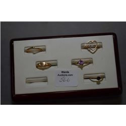 Five 10kt yellow gold rings including small heart shaped with tiny diamond gemstone, gemstone baby r