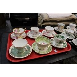 Twelve china cups and saucers including Royal Albert, Royal Vale etc. plus a Gibsons pottery tea pot