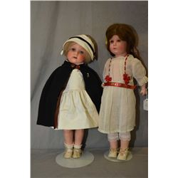 Two antique painted bisque dolls head dolls on composition bodies including Armand Marseille 449, 19