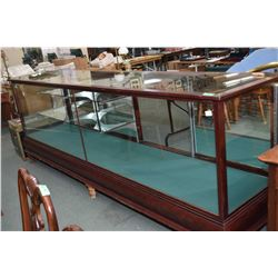 Huge 10' long antique oak retail display counter with cast claw feet