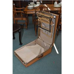 Vintage travel case with hanging wardrobe section and divided base, original wooden hanger marked Mc