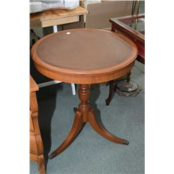 """Leather top mahogany single pedestal occasional table with brass capped feet, 24"""" in diameter"""