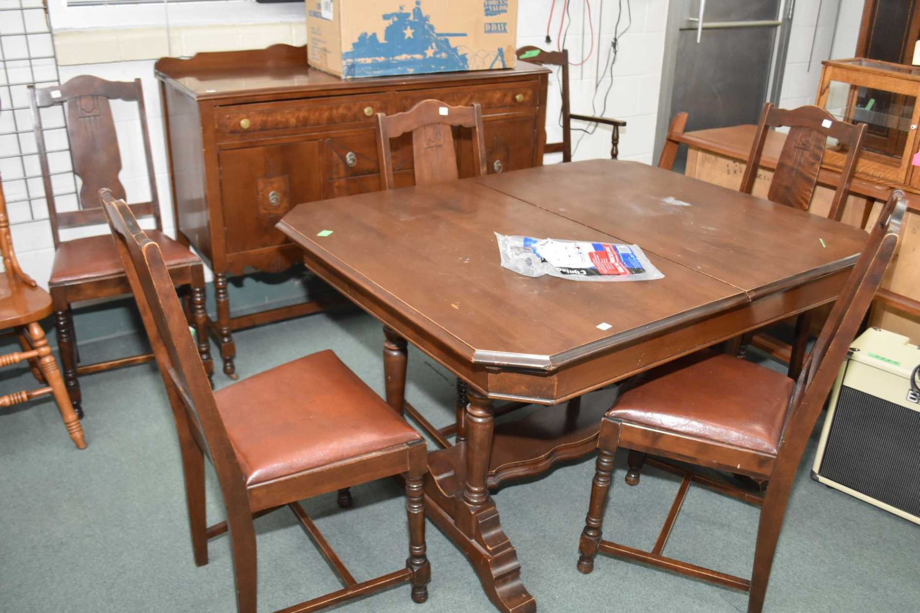 Depression era walnut dining room suite including table with ...