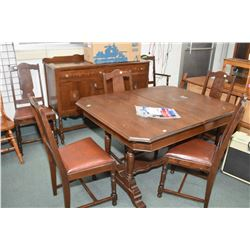 Depression era walnut dining room suite including table with jack knife leaf, six chairs including o