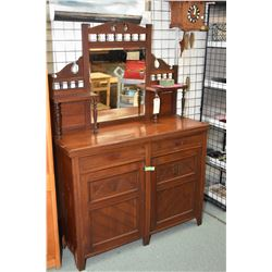 Small antique mahogany sideboard with bevelled mirrored backboard